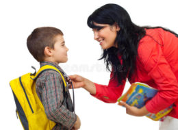 mother-preparing-son-school-16258261
