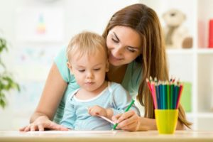 1200-540372164-babysitter-drawing-with-baby