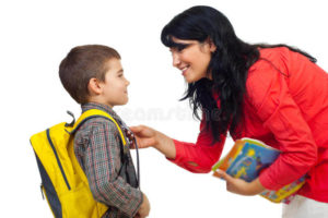 mother-preparing-son-school-16258261